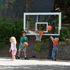 Young children play on lowered goal