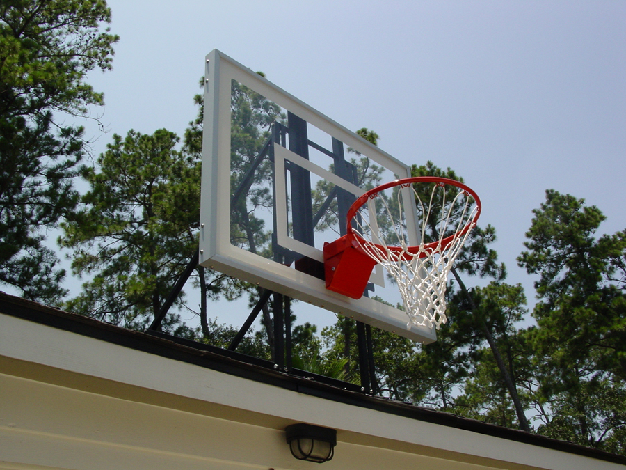... Competitive Young Child Goes In For A Layup On A Lowered Goal ...