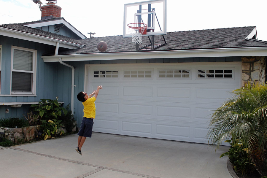 Roof king gold basketball system for Basketball garage